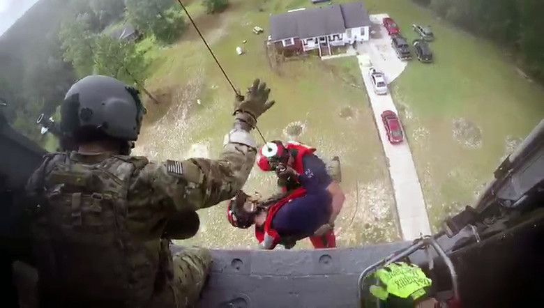 Members of 106th Rescue Squadron go in for the save during Hurricane Florence